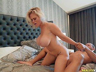 Gorgeous blonde MILF is riding a black cock