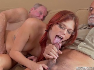 Redhead cutie handles two geriatric dicks