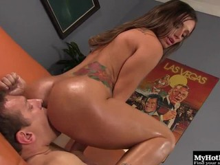 Oiled babe with a perfect body performs a mind-blowing dick ride