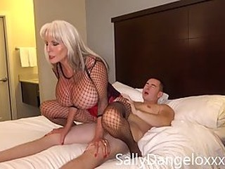 Blonde milf with massive tits has many handsome visitors and she mostly ends up fucking them