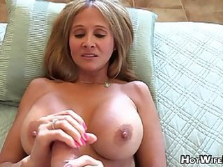 Mature blonde housewife with big milk jugs is playing with her lover's rock hard dick