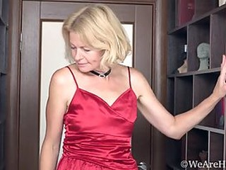 Mature blonde woman, Diana Douglas took off her red, satin dress and started masturbating like crazy
