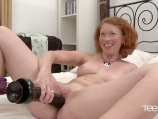 Ginger Russian plays with her vag and takes a warm load