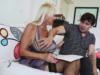 Blonde granny in stockings breaks a sweat on a younger stud's cock hardcore