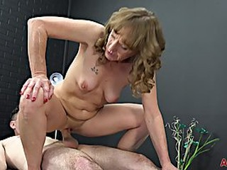 Experienced masseuse, Cyndi Sinclair sucks cock every once in a while, instead of doing her job