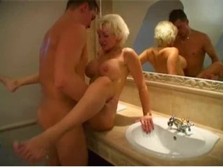 Busty blonde mature fucked in her bathroom