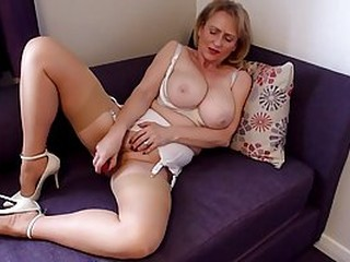 Big titted granny likes to put on erotic lingerie and drill her pussy with a sex toy