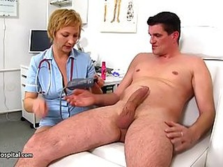 Dirty minded, blonde nurse is playing with her patient's cock and spreading up wide, for him