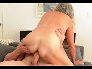Horny, mature blonde with big boobs is sucking her lover's dick and getting fucked from the back