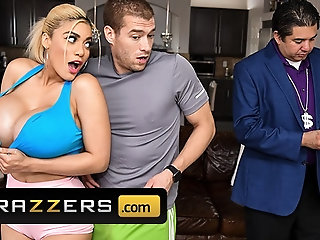 Busty blonde Amber Alena shows her huge boobs and seduces handsome trainer